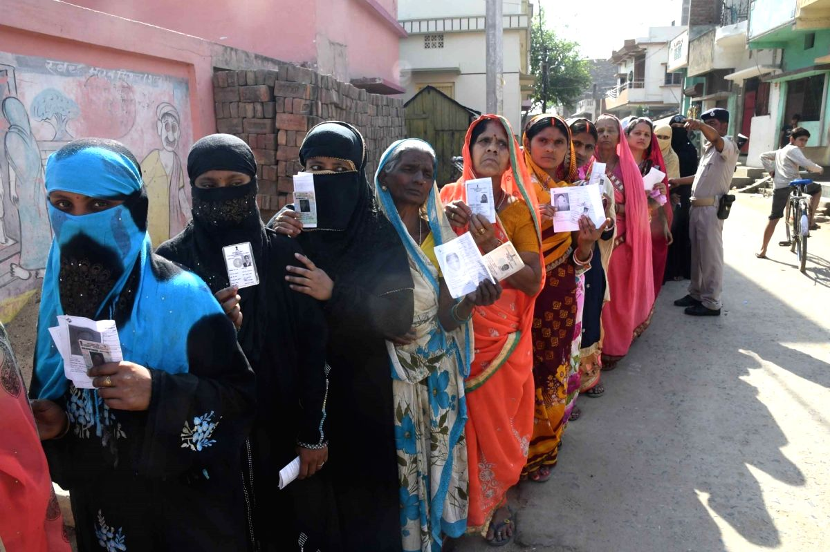 Hajipur (Bihar): Voters queue up at a polling station to cast their votes for the fifth phase of 2019 Lok Sabha elections, in Bihar's Hajipur on May 6, 2019.