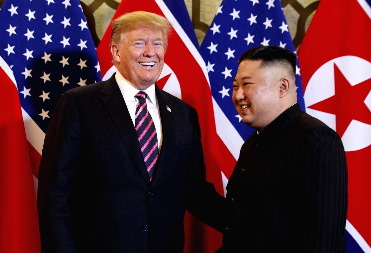 Hanoi: This AP photo shows U.S. President Donald Trump (L) and North Korean leader Kim Jong-un smiling before a summit meeting at the Sofitel Legend Metropole Hanoi on February 27, 2019. (Yonhap/IANS)