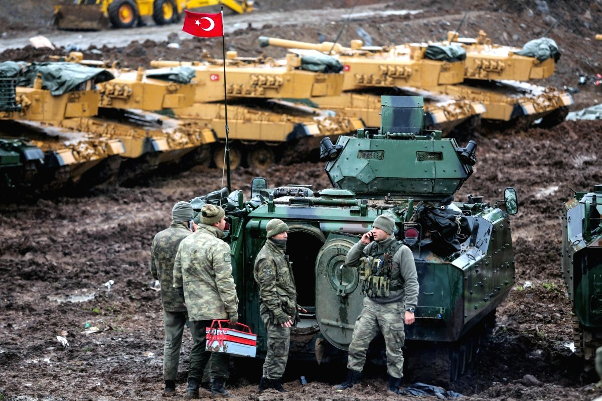 """HATAY (TURKEY), Jan. 23, 2018 (Xinhua) -- Turkish soldiers are seen with their armored vehicles near Turkish-Syrian border in Hatay, Turkey, on Jan. 23, 2018. Turkish military's operations in Syria will continue """"until all terrorists are fully elimin"""