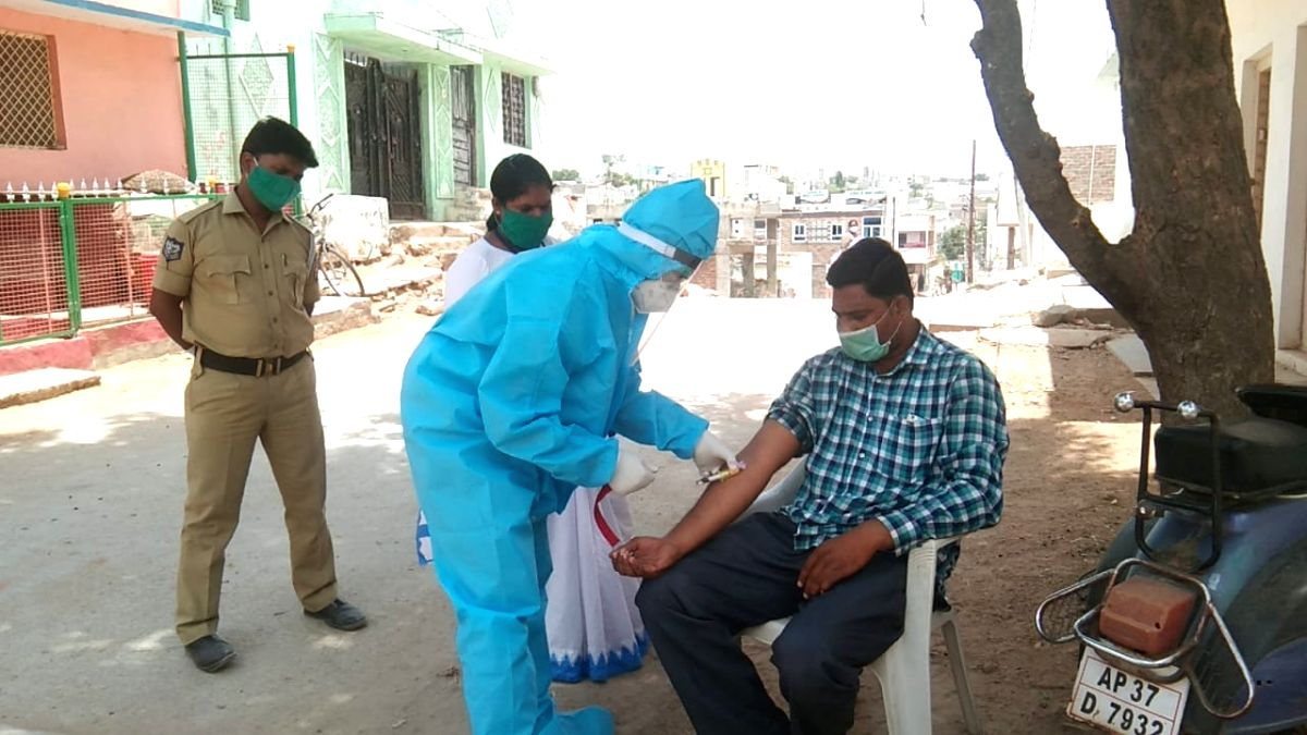 Health workers collect samples for COVID-19 testing at Balapur Mandal in Telangana's Ranga Reddy district which is on high alert due to an increase in the number of coronavirus cases, on May 30, 2020.
