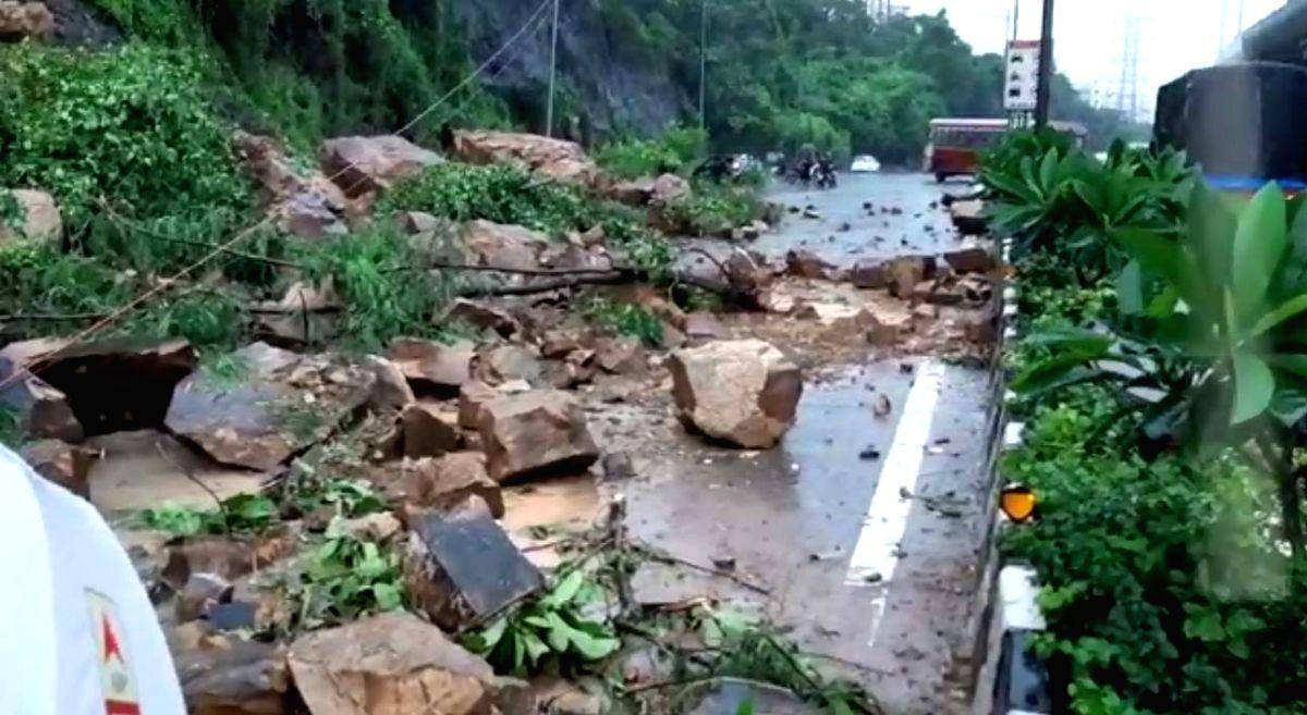 Heavy rains pound Mumbai, landslide hits road, rail traffic.