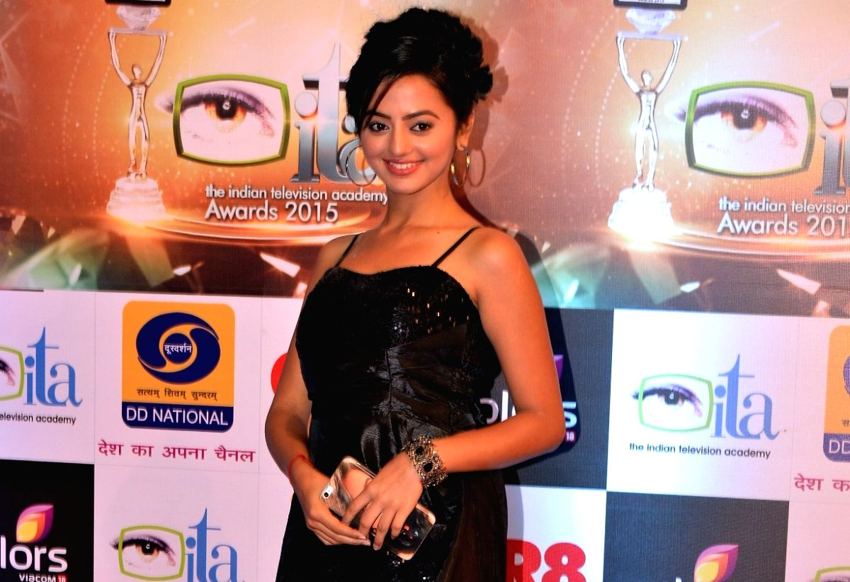 Helly Shah is overjoyed on meeting people after such a long hiatus. (Image Source: IANS)