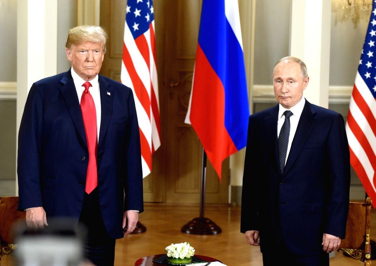 HELSINKI, July 16, 2018 (Xinhua) -- U.S. President Donald Trump (L) meets with his Russian counterpart Vladimir Putin in Helsinki, Finland, on July 16, 2018. U.S. President Donald Trump and his Russian counterpart Vladimir Putin started their first b