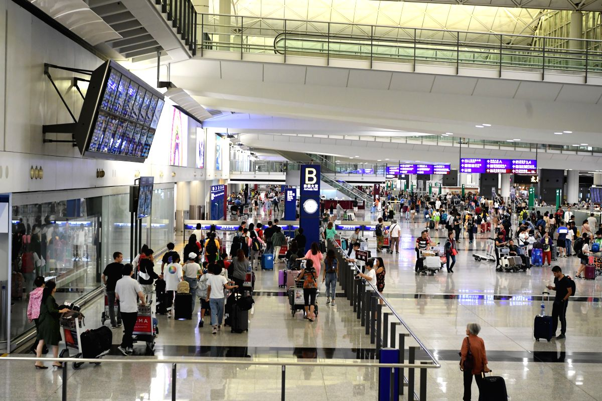 HONG KONG, Aug. 15, 2019 (Xinhua) -- Photo taken on Aug. 15, 2019 shows travellers in the arrivals hall at Hong Kong International Airport in Hong Kong, south China.   The operation of Hong Kong International Airport returned to normal on Thursday, t