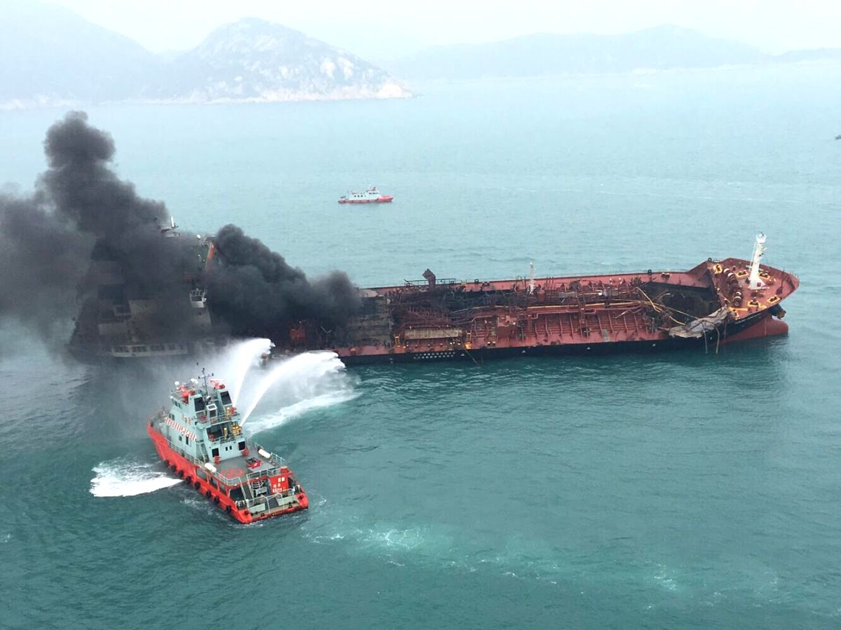 HONG KONG, Jan. 8, 2019 (Xinhua) -- A rescue boat puts out fire that occurred on an oil tanker off Hong Kong's Lamma Island, Jan. 8, 2019. One person was killed, seven injured and two missing as an oil tanker exploded and caught fire Tuesday.  The ac