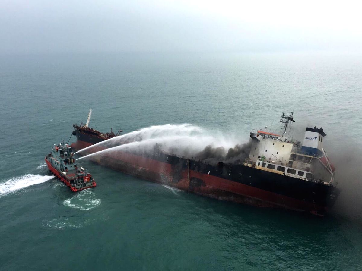 HONG KONG, Jan. 8, 2019 (Xinhua) -- A rescue boat puts out fire that occurred on an oil tanker off Hong Kong's Lamma Island, Jan. 8, 2019. One person was killed, seven injured and two missing as an oil tanker exploded and caught fire Tuesday. The acc