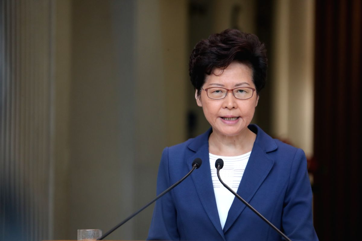 """HONG KONG, Oct. 8, 2019 (Xinhua) -- Chief executive of China's Hong Kong Special Administrative Region (HKSAR) Carrie Lam meets the press in Hong Kong, south China, Oct. 8, 2019. Lam said Tuesday that the """"unprecedented violence"""" these days have sent"""