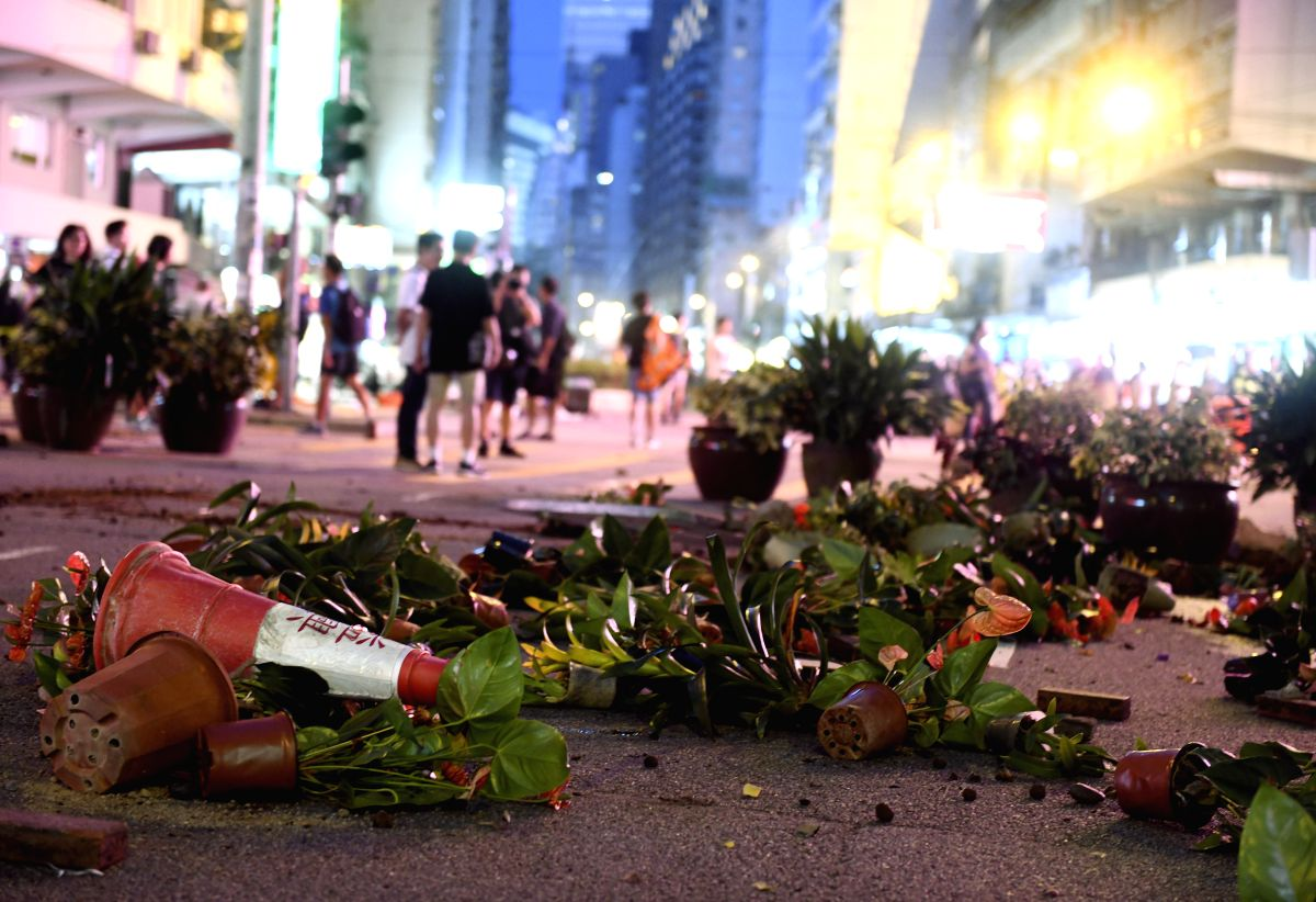 HONG KONG, Sept. 15, 2019 (Xinhua) -- Photo taken on Sept. 15, 2019 shows damaged greening plants on Hennessy Road in Hong Kong, south China. Rioters set fires in Central and Admiralty areas, threw petrol bombs at the Hong Kong Special Administrative