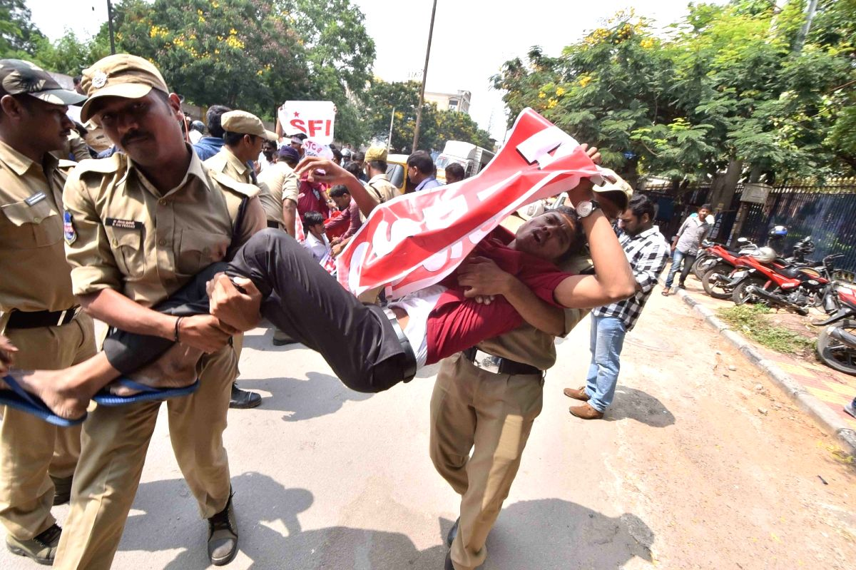 Hyderabad: A Left Front activist being detained by the police during their demonstration at Bus Bhavan in Hyderabad on Oct 14, 2019.