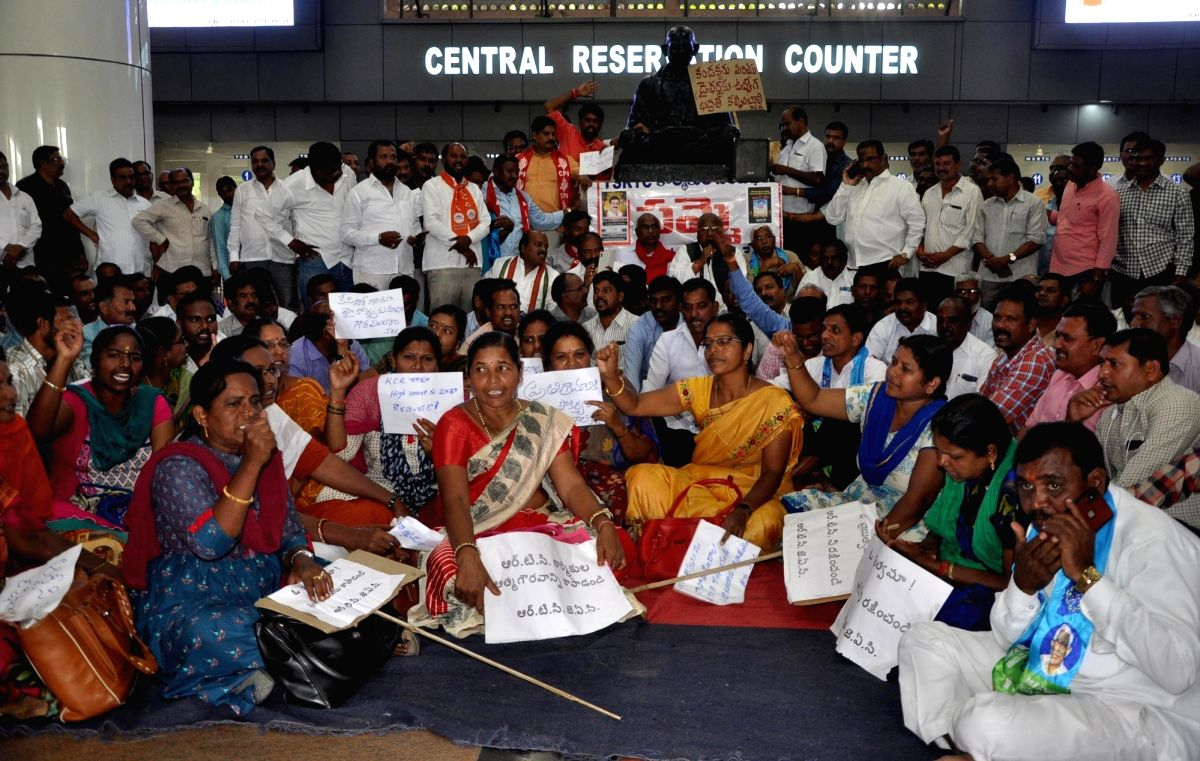 Hyderabad: Members of the Joint Action Committee (JAC) of Telangana State Road Transport Corporation (TSRTC) stage a sit-in demonstration at a bus depot, in Hyderabad on Oct 21, 2019.