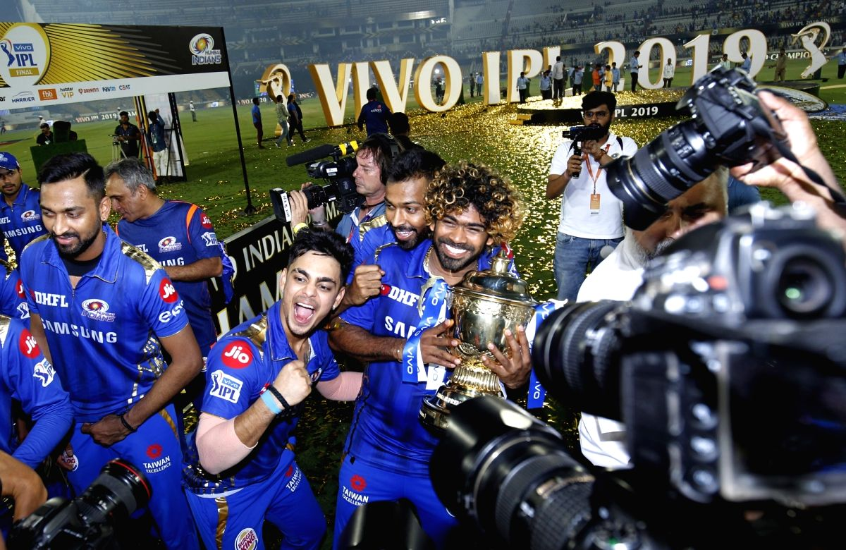 Mumbai Indians' pose with the IPL 2019 Champions trophy after winning the Final match of IPL 2019 against Chennai Super Kings at Rajiv Gandhi International Stadium in Hyderabad. Mumbai Indians won by 1 run. Mumbai Indians
