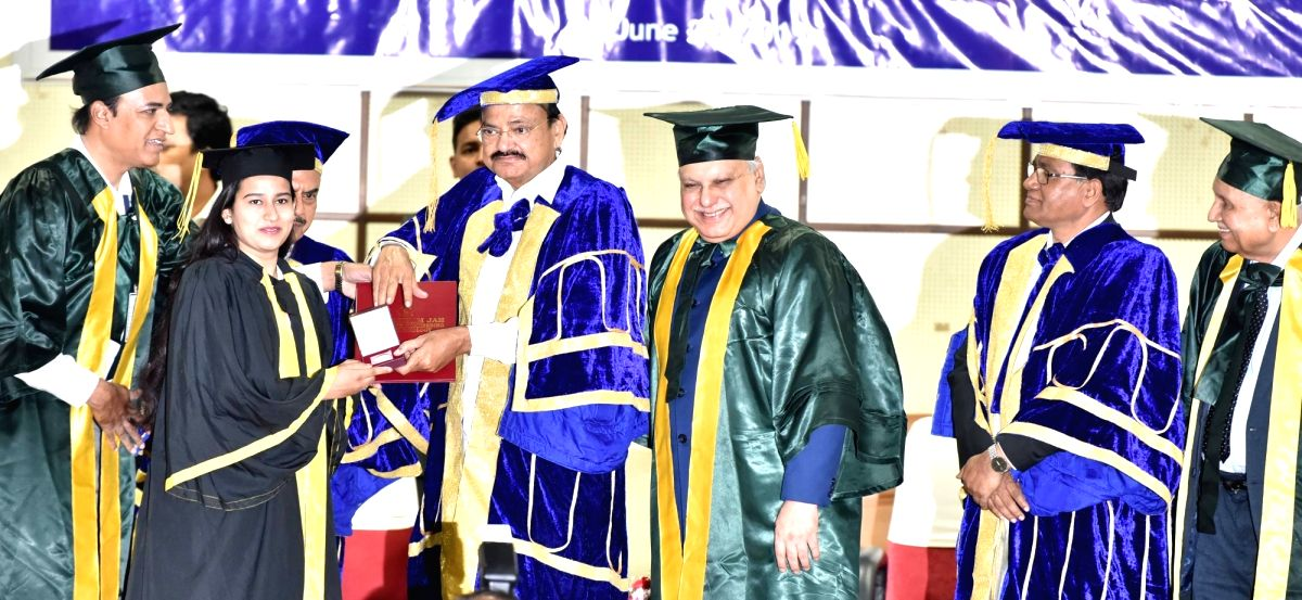 Hyderabad: Vice President M. Venkaiah Naidu presents Gold Medal to a student at the Graduation Day Ceremony of the Muffakham Jah College of Engineering and Technology, in Hyderabad on June 29, 2019. Speaking at the ceremony, Vice President M. Venkaia