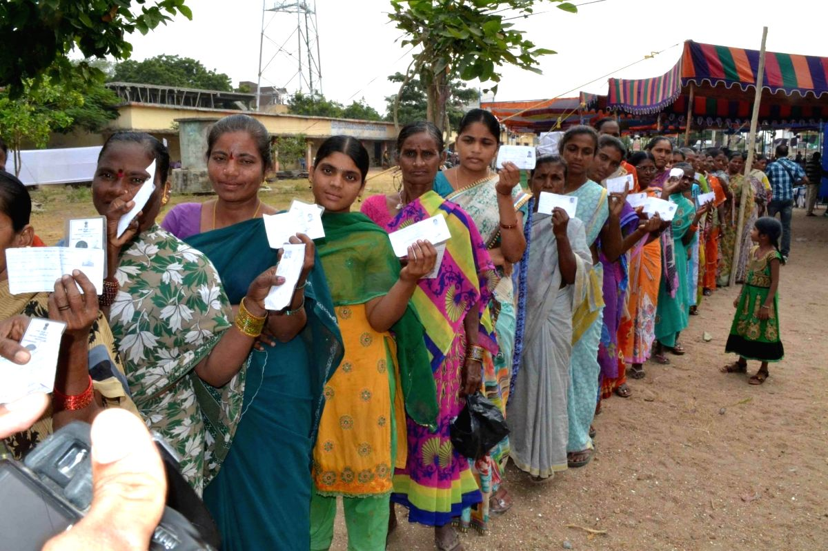 Hyderabad: Women show their voter ID cards as they wait in a queue to cast their vote at a polling station for the by-election to the Warangal Lok Sabha constituency in Telangana on Nov 21, 2015.