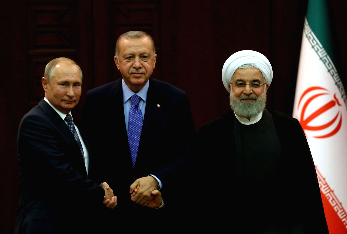 Iran, Russia, Turkey urge political solution to Syrian crisis