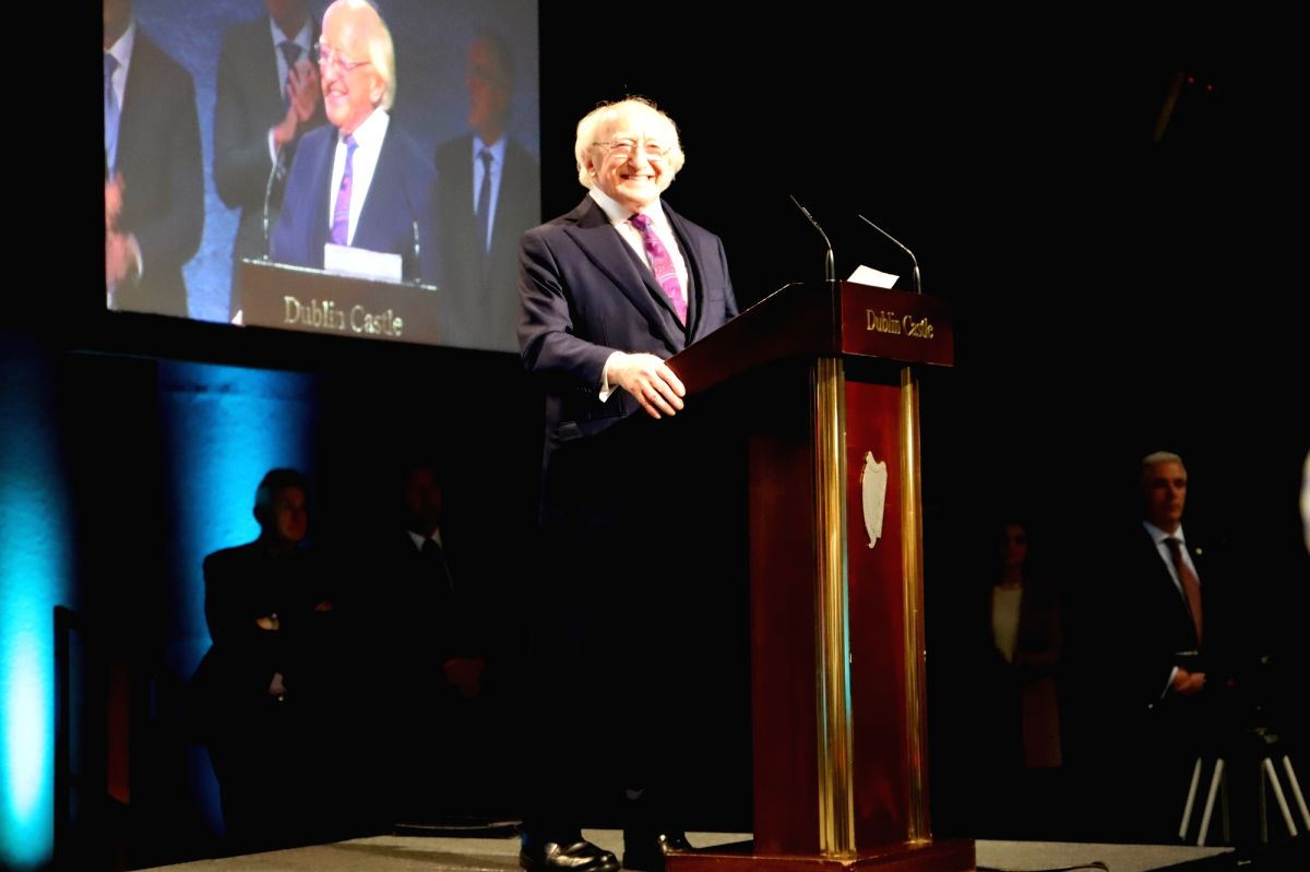 Irish President Michael D. Higgins (C) delivers a speech after he was re-elected as the president in Dublin, Ireland
