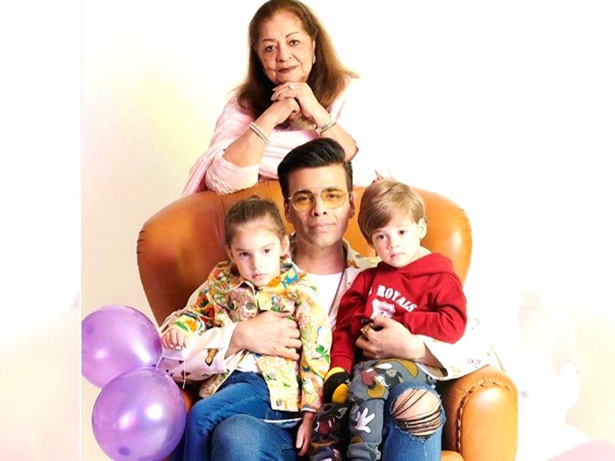 Karan Johar with his mom, son Yash and daughter Roohi