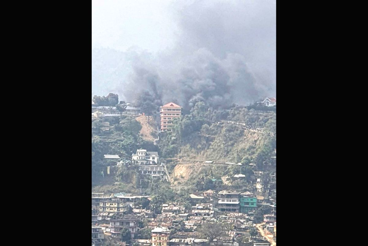 Itanagar: Smoke rises from Arunachal Pradesh Deputy Chief Minister Chowna Mein's residence, in Itanagar, Arunachal Pradesh, on Feb 24, 2019. According to source, mobs protesting against the permanent resident certificate (PRC) continued their violenc