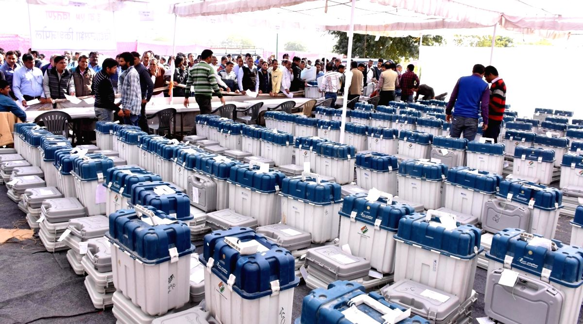 Jaipur: Polling officials wait in multiple queues to collect Electronic Voting Machines from a distribution center before leaving for their respective polling stations, on the eve of Rajasthan Assembly elections, in Jaipur on Dec 6, 2018. (Photo: Rav