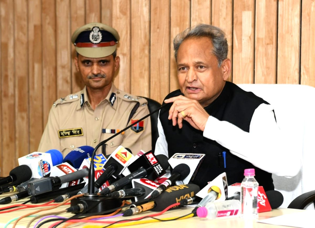 Jaipur: Rajasthan Chief Minister Ashok Gehlot accaompanied by state DGP Bhupendra Singh,  addresses a press conference at the police headquarters in Jaipur on Sep 4, 2019.