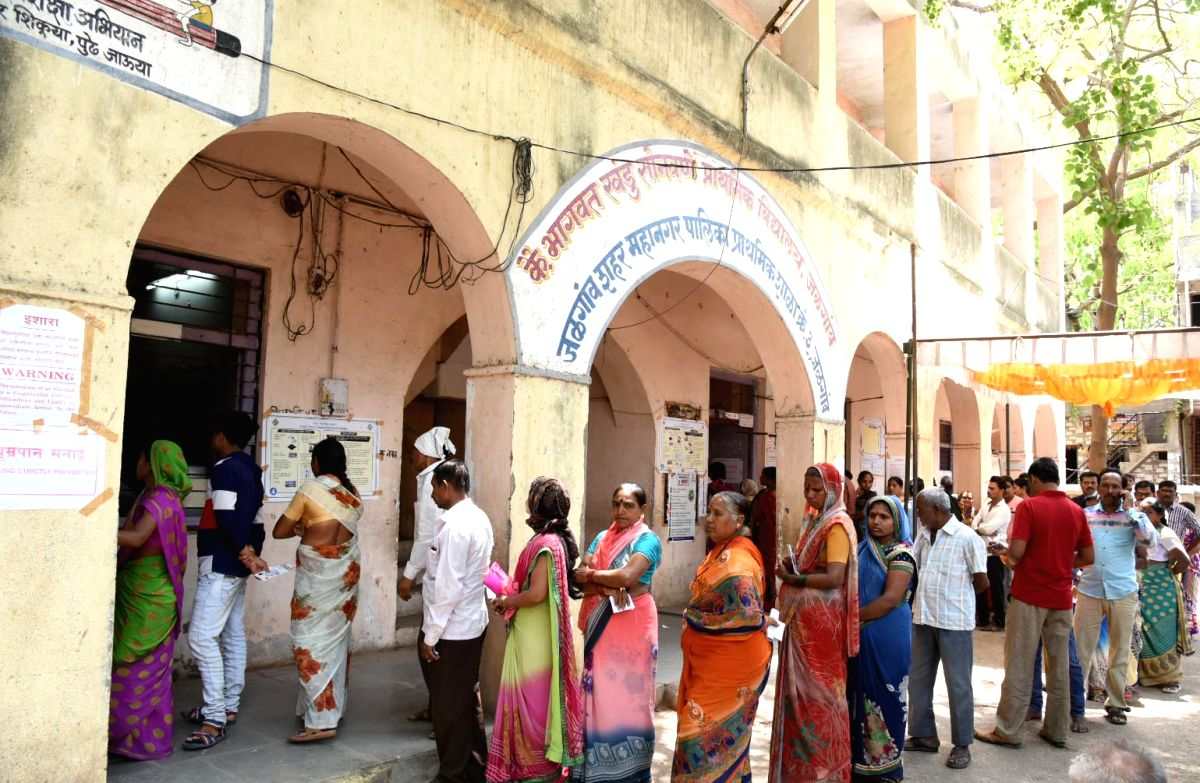 Jalgoan (Maharashtra): Voters wait in a queue to cast their votes for the third phase of 2019 Lok Sabha elections, at a polling booth in Jalgoan, Maharashtra on April 23, 2019. (Photo: IANS/PIB)
