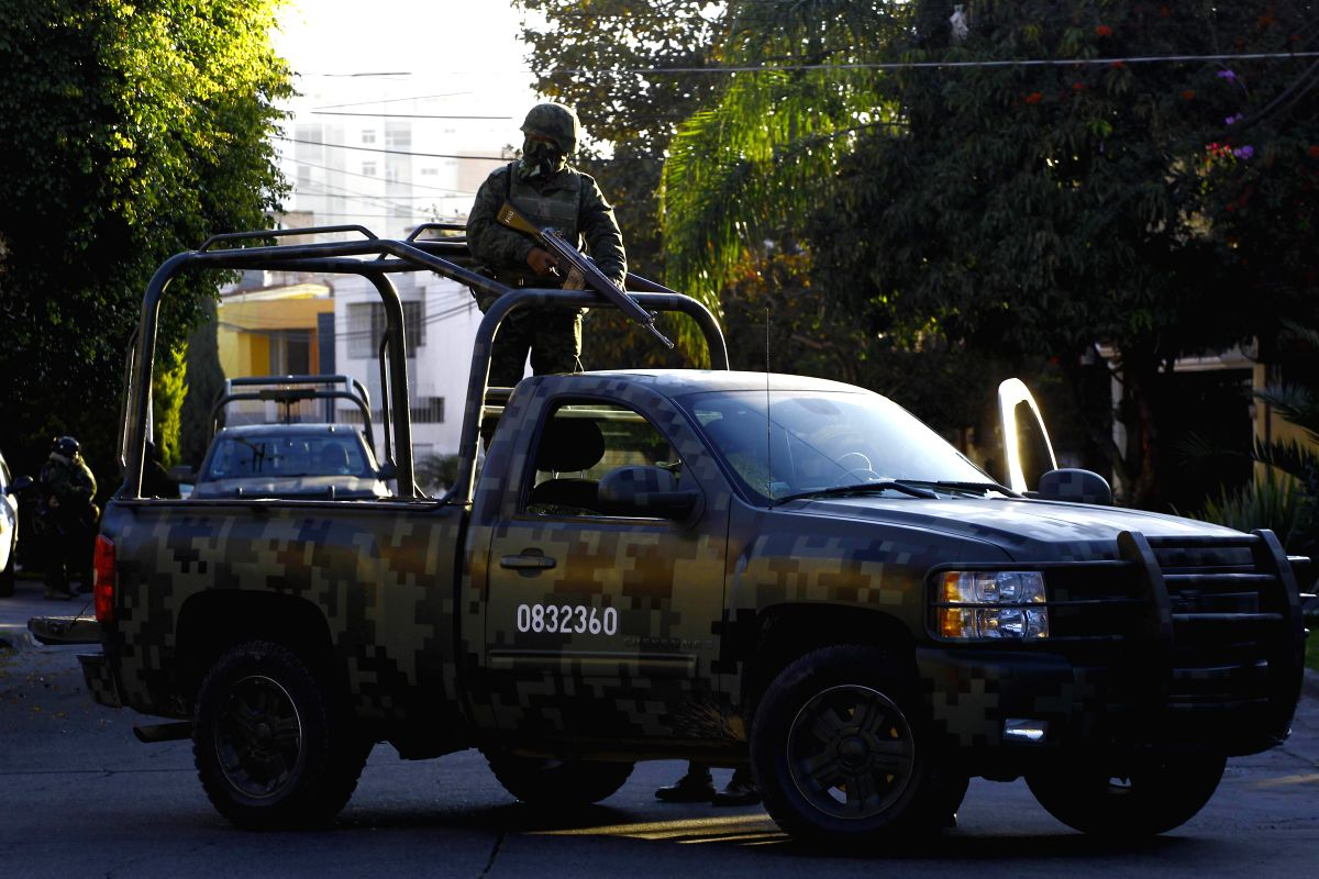 JALISCO, Jan. 31, 2014 (Xinhua) -- Members of the Mexican Army stand guard after a raid arresting Ruben Oseguera Gonzalez, son of the alleged leader of the Jalisco new generation cartel, Nemesio Oseguera Cervantes, in Zapopan, Jalisco, Mexico, on Jan