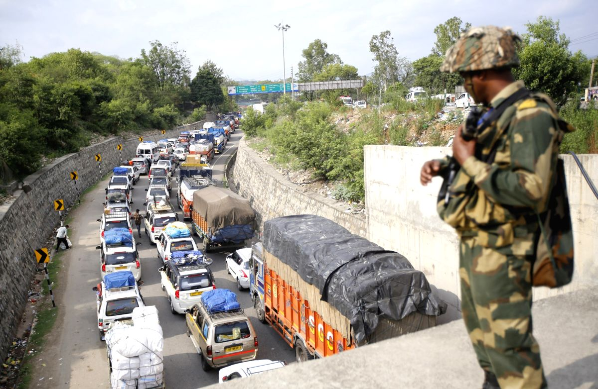 Jammu: A queue of stranded vehicles on the Jammu-Srinagar National Highway after it was closed during restrictions imposed by authorities to prevent separatist called protests in connection with the Martyrs Day; in Jammu on July 13, 2019. July 13 is