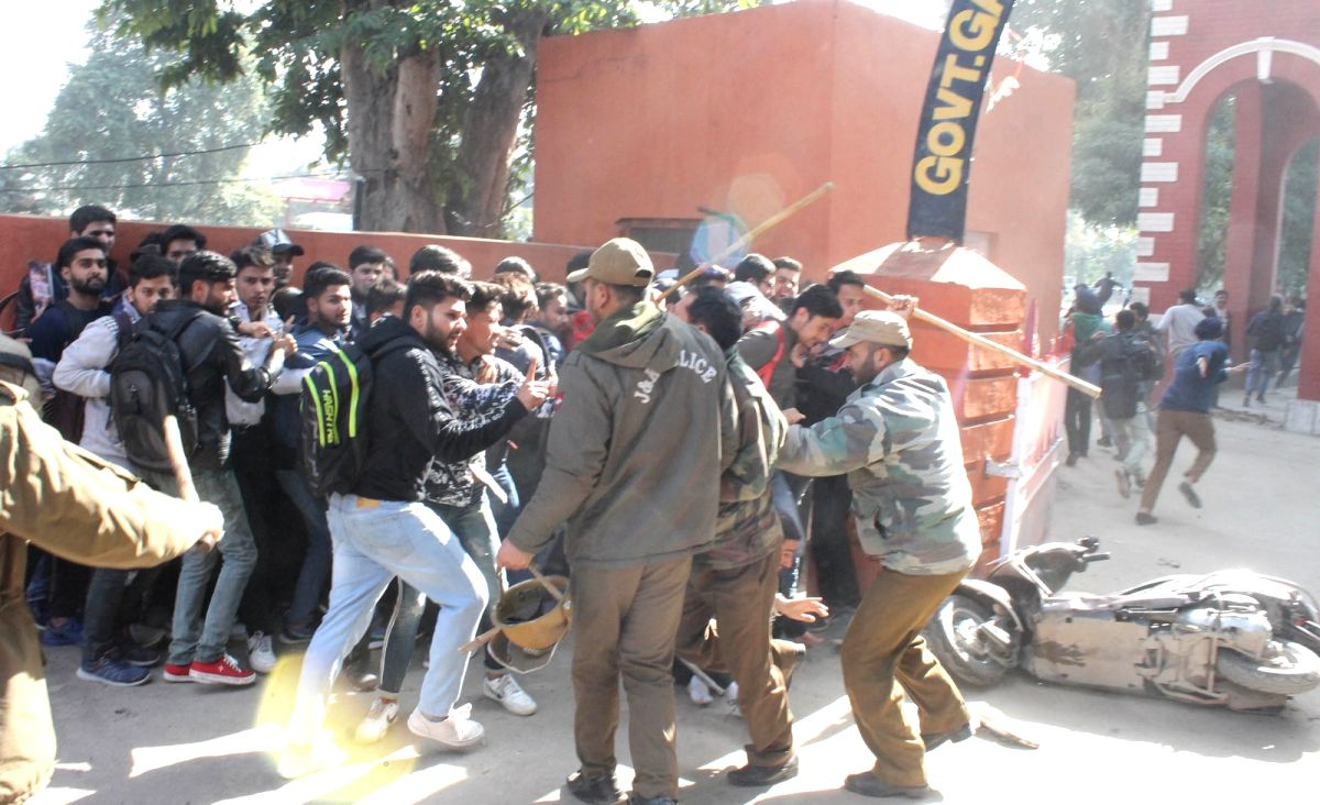 Jammu: Clashes erupt in Jammu after local students pelted stones on stranded Kashmiri passengers who raised slogans against the state administration on Feb 11, 2019. With the Jammu-Srinagar Highway remaining closed for the sixth consecutive day on Mo