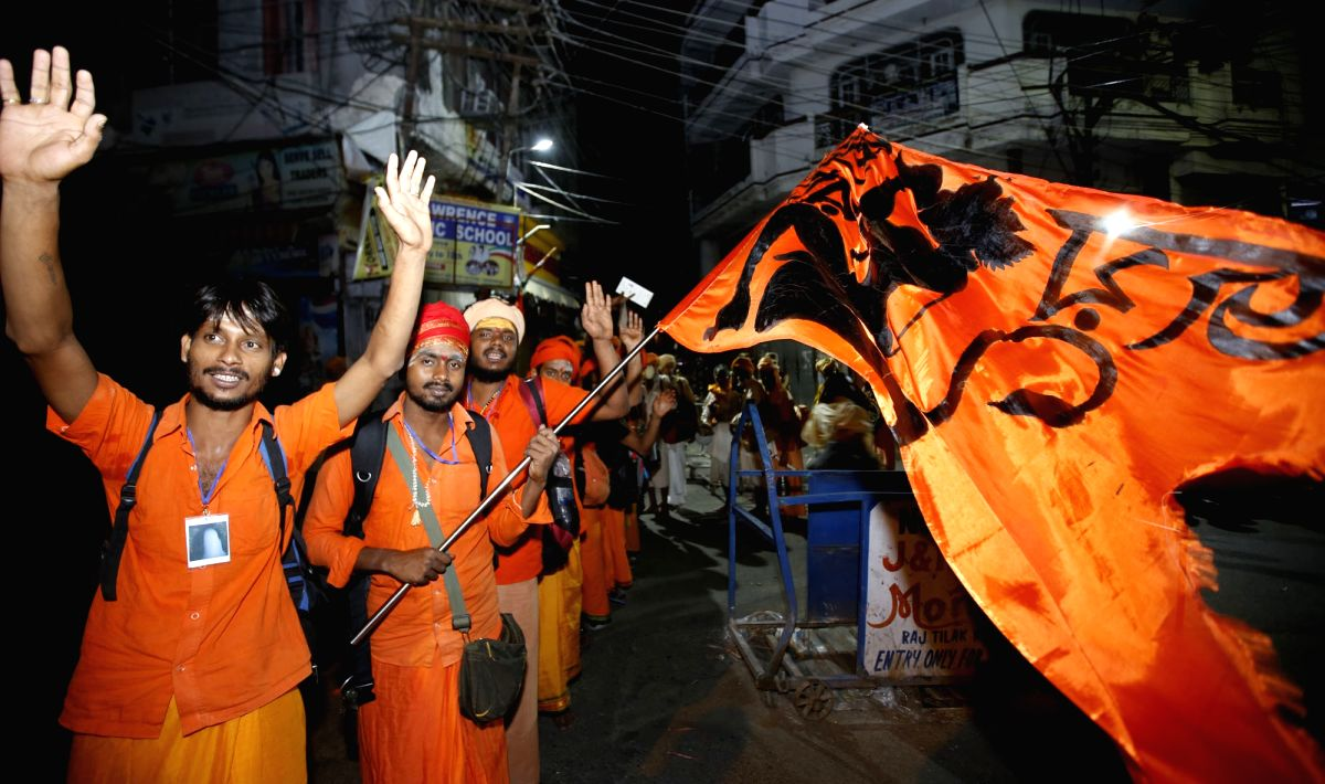 Jammu: Devotees chant religious slogans as they leave for the 45-day long annual Hindu pilgrimage - Amarnath Yatra, in Jammu on July 6, 2019.