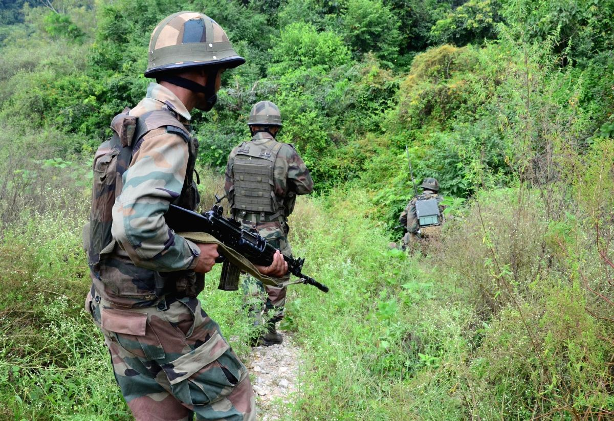 Jammu: Security personnel carry out search operations after three militants travelling in a truck from Jammu to Srinagar opened fire at a checkpost near the Jhajar Kotli police station, in Jammu on Sept 12, 2018. Central Reserve Police Force (CRPF) t