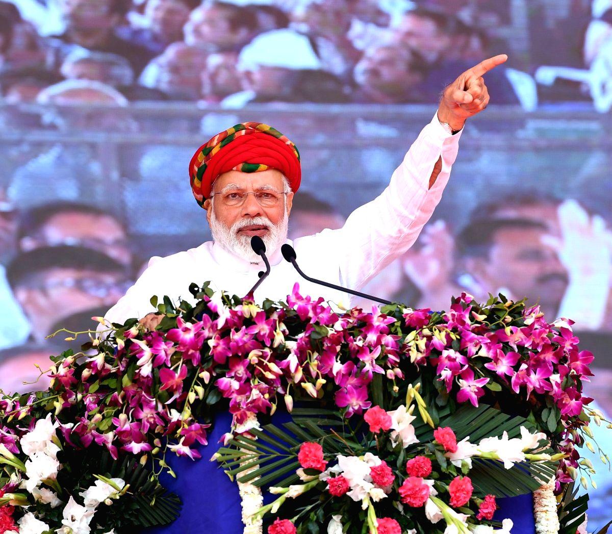 Jamnagar: Prime Minister Narendra Modi addresses at the inauguration of various development projects in Gujarat's Jamnagar, on March 4, 2019. (Photo: IANS/PIB)