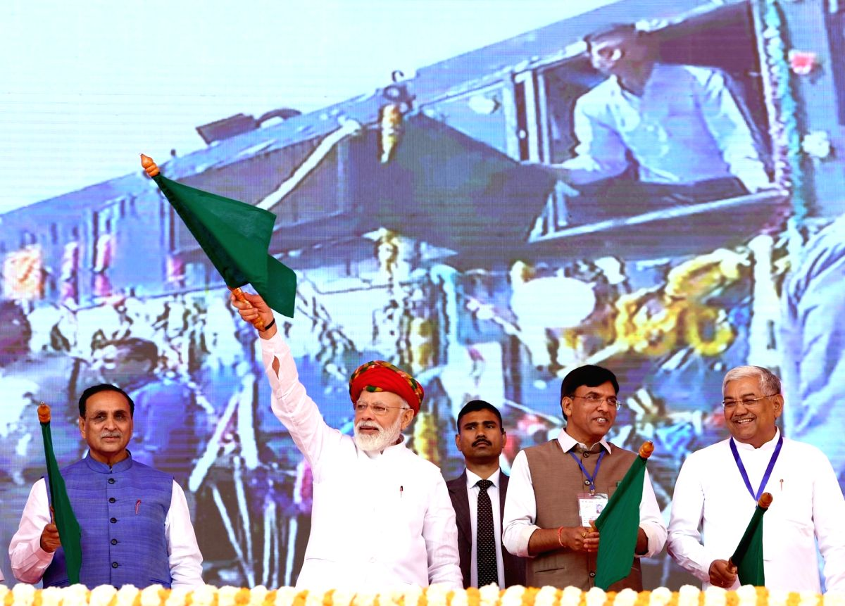 Prime Minister Narendra Modi flags off various development projects in Gujarat's Jamnagar. Also seen Gujarat Chief Minister Vijay Rupani and Union MoS Road Transport and Highways, Shipping and Chemicals and Fertilizers Man