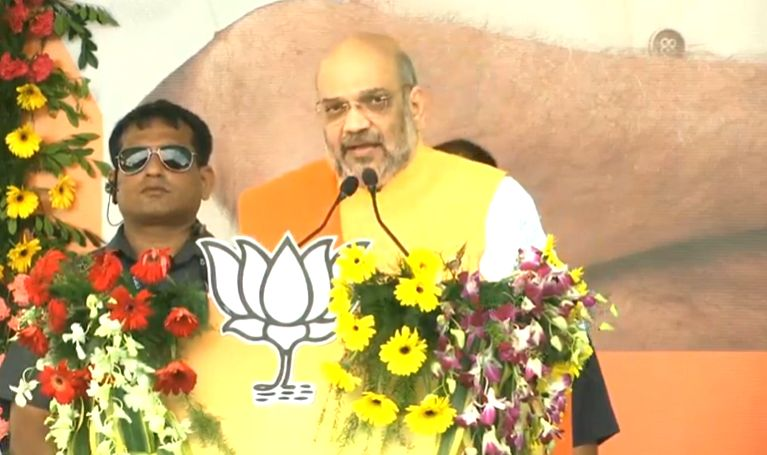 Jamtara: Union Home Minister Amit Shah addresses at the flagging off ceremony of 'Johar Jan Ashirwad Yatra' ahead of Jharkhand Assembly elections 2019, in Jamtara on Sep 18, 2019.