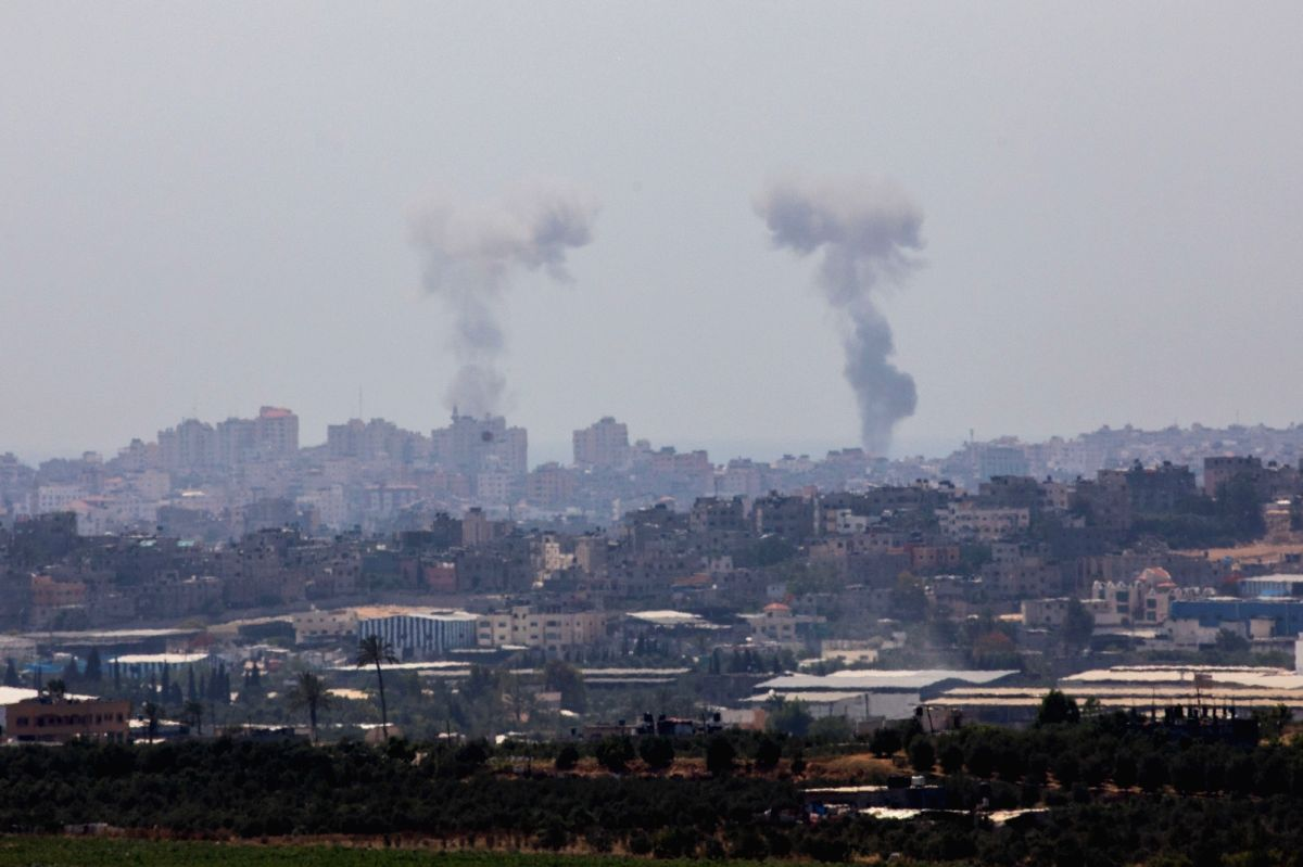 JERUSALEM, May 29, 2018 (Xinhua) -- Smoke rises from Gaza Strip on May 29, 2018. Palestinian militants fired dozens of mortars, projectiles and rockets into Israel throughout Tuesday before Israel launched a wide-scale airstrike on Gaza, as tensions