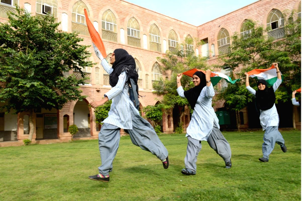 Jodhpur: Indians wave the tri-colour on the eve of Independence Day in Jodhpur on Aug 14, 2016.