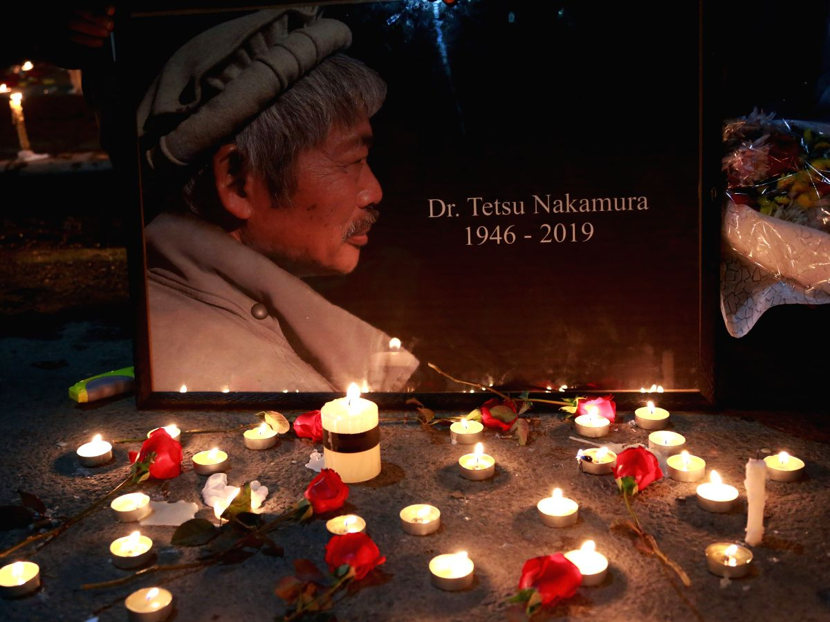 KABUL, Dec. 6, 2019 (Xinhua) -- Candles are seen at a vigil to express sorrow over the killing of Japanese aid worker Tetsu Nakamura by unknown armed men in Kabul, Afghanistan, Dec. 5, 2019. Afghans from all walks of life have expressed sorrow over t