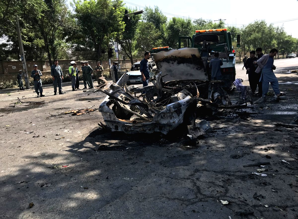 KABUL, July 19, 2019 (Xinhua) -- Afghan security force members inspect the site of a blast at the southern gate of Kabul University in Kabul, Afghanistan, July 19, 2019. Four people were killed and 16 others sustained injuries as a blast hit the sout