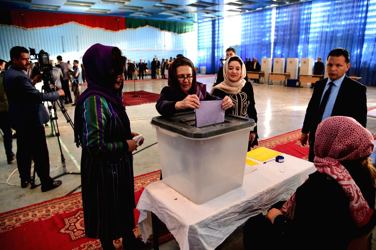 KABUL, Oct. 20, 2018 (Xinhua) -- Afghan First Lady Rula Ghani (C) casts her ballot at a polling center during parliamentary elections in Kabul, Afghanistan, Oct. 20, 2018. Millions of Afghan voters cast their ballots on Saturday for long-delayed parl