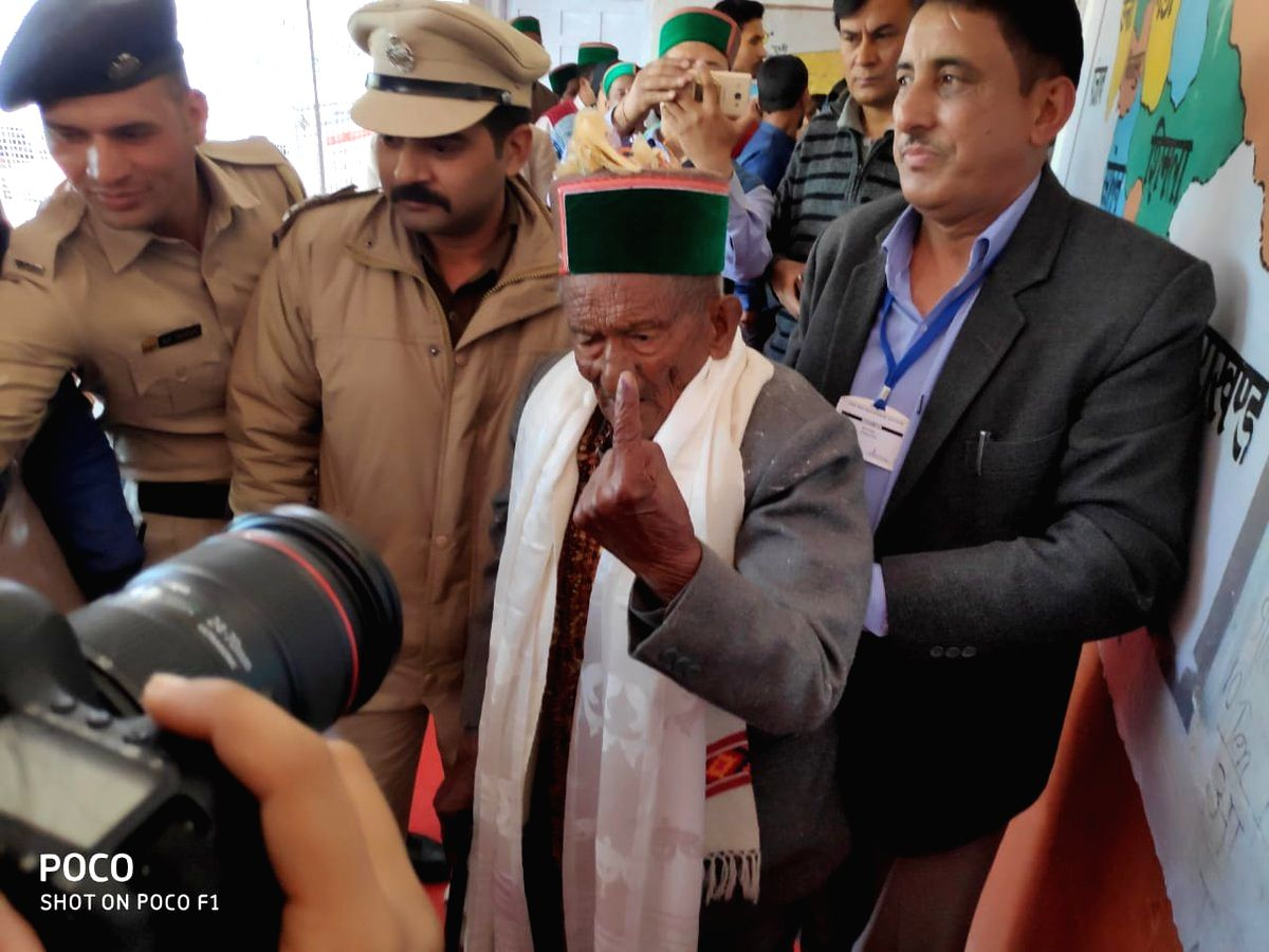 Kalpa: 1st voter of independent India, Shyam Saran Negi shows his forefinger marked with indelible ink after casting vote during the seventh and the last phase of 2019 Lok Sabha Elections at a polling booth in Kalpa, Kinnnaur, Himachal Pradesh on May