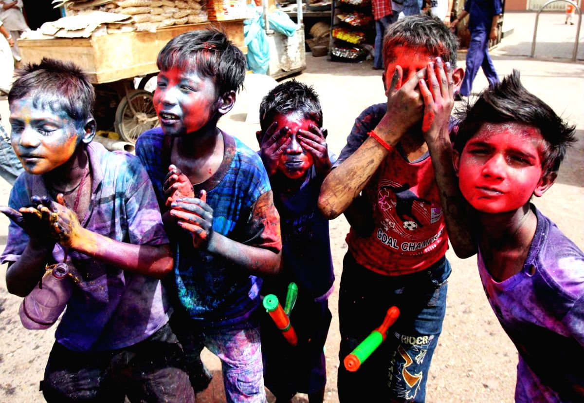 KARACHI - Pakistani Hindu children with colored powder on their faces celebrate Holi festival in southern Pakistani port city of Karachi.