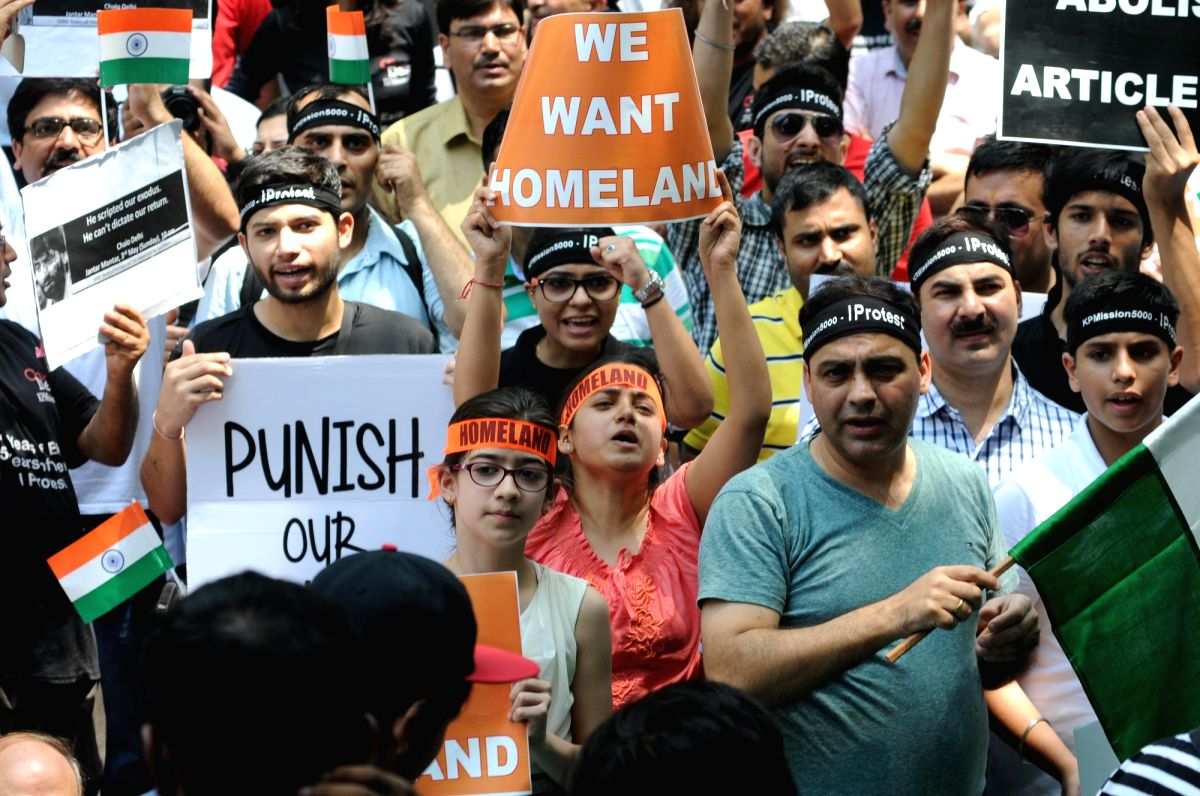 =Kashmiri Pandits stage a demonstration to demand their participation in decisions regarding their return to the valley, at Jantar Mantar in New Delhi.