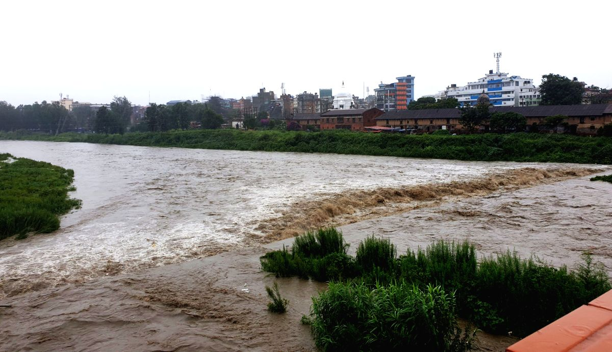 KATHMANDU, July 12, 2019 (Xinhua) -- Photo taken on July 12, 2019 shows the swollen Bagmati river after heavy rainfall in Kathmandu, Nepal. Heavy rains leave Nepalese people at risks of floods and landslides during Monsoon season. Meteorological Fore