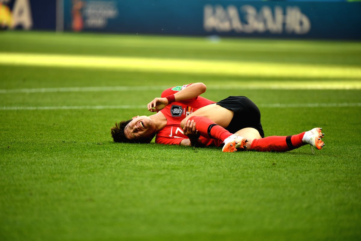 South Korea's Lee Jaesung in pain after an injury in the match between Germany and South Korea