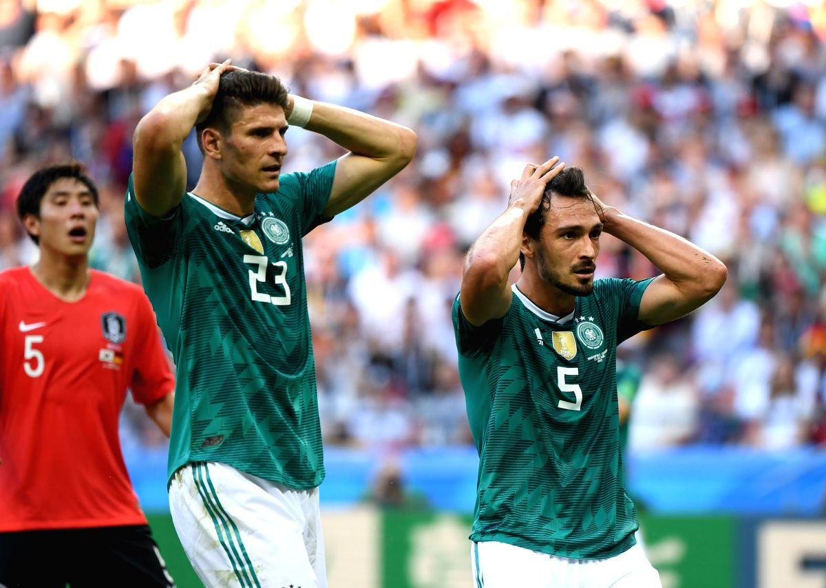 Mario Gomez and Mats Hummels react after a disappointing game between Germany and South Korea