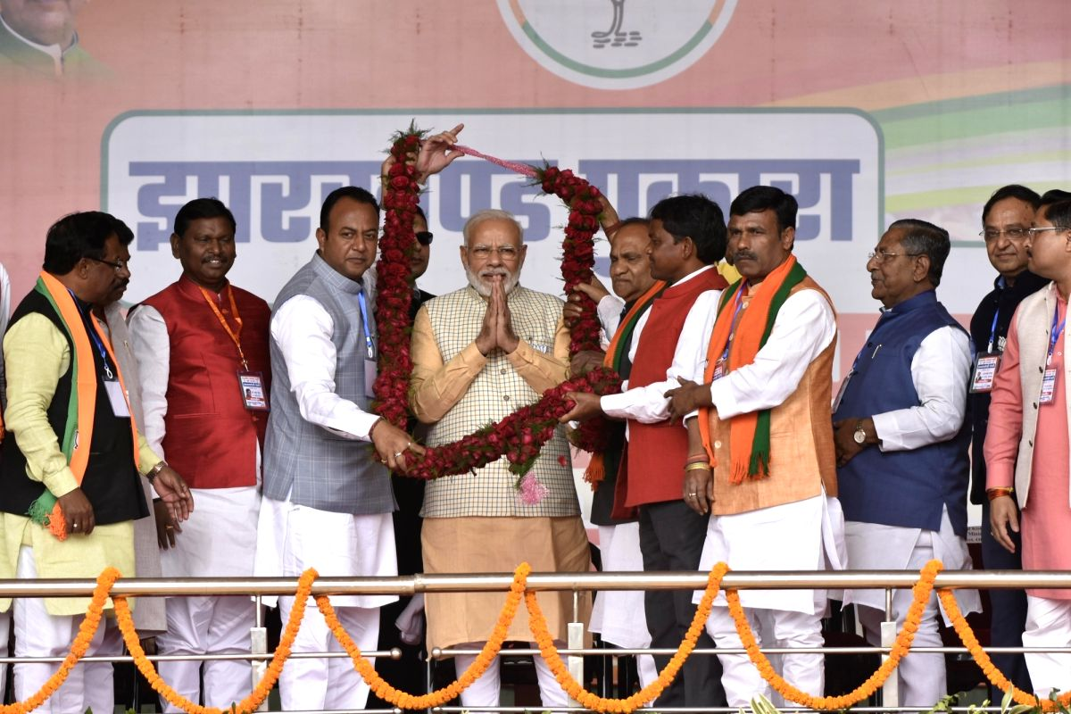 Khunti: Prime Minister Narendra Modi being welcomed by BJP's candidates from Hatia and Ranchi Assembly seats, Navin Jaiswal and CP Singh respectively during a public meeting ahead of the second phase of Jharkhand Assembly elections, in Khunti distric