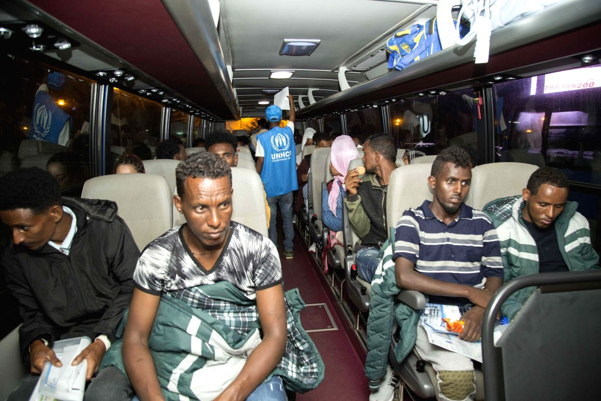 KIGALI, Oct. 11, 2019 (Xinhua) -- African refugees and asylum-seekers who have been living in Libya's detention centers ride a bus in Kigali, Rwanda on Oct. 10, 2019. Rwanda late Thursday received 123 African refugees and asylum-seekers who have been