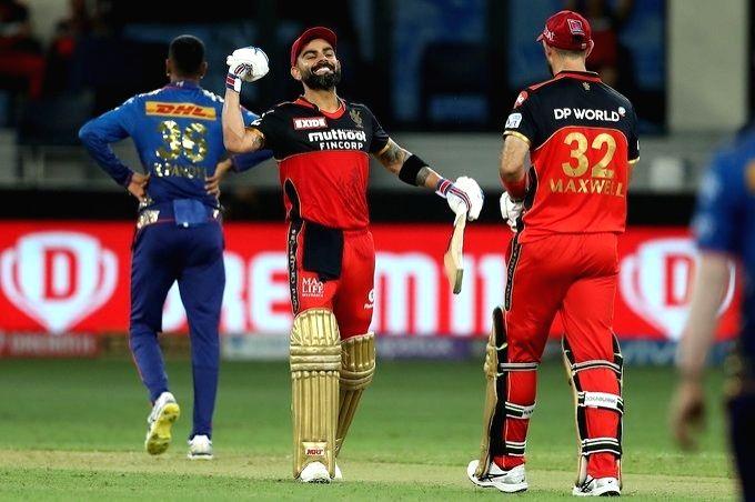 Kohli, Maxwell fifties help RCB reach 165/6 vs Mumbai Indians