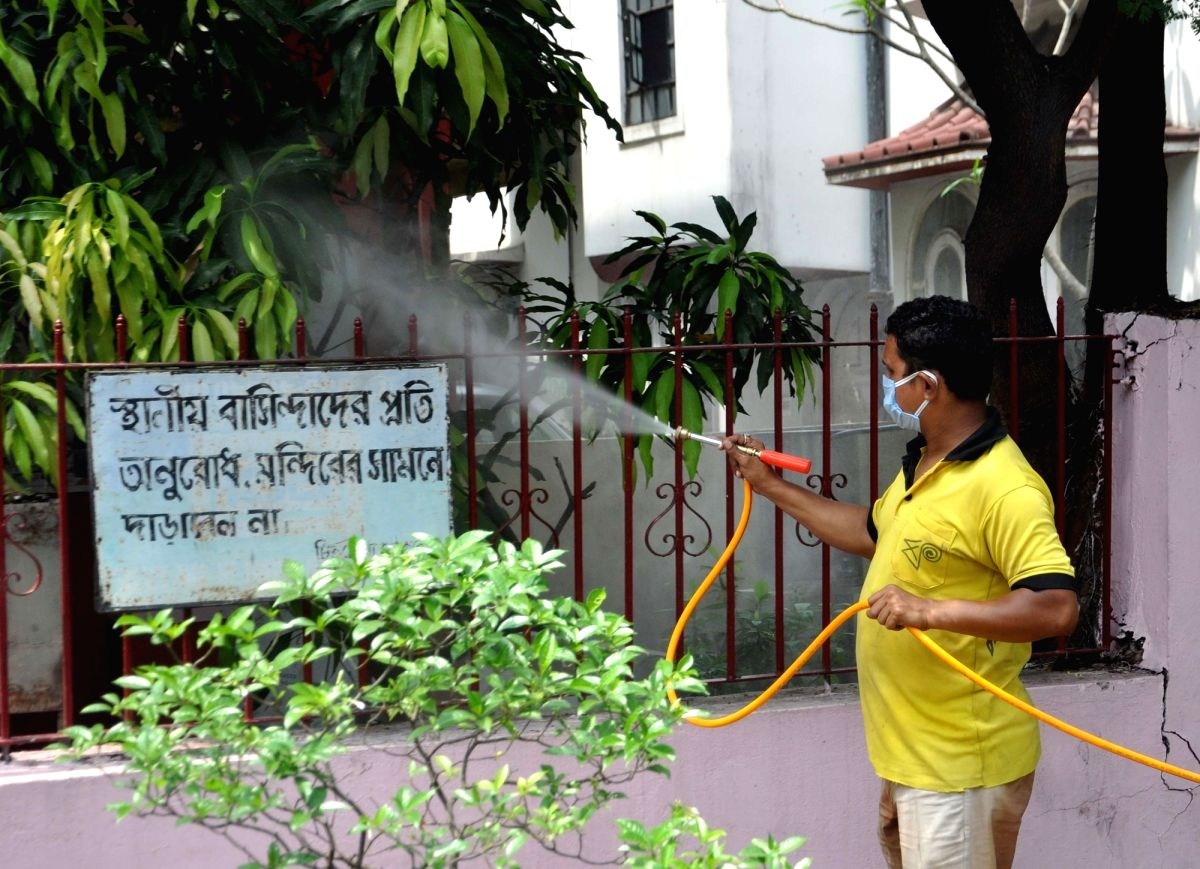 Kolkata: A municipal worker sprays disinfectants a Kolkata's Salt Lake as part of a sanitisation drive being conducted across the city during the extended nationwide lockdown imposed to mitigate the spread of coronavirus pandemic, on Apr 16, 2020. (P