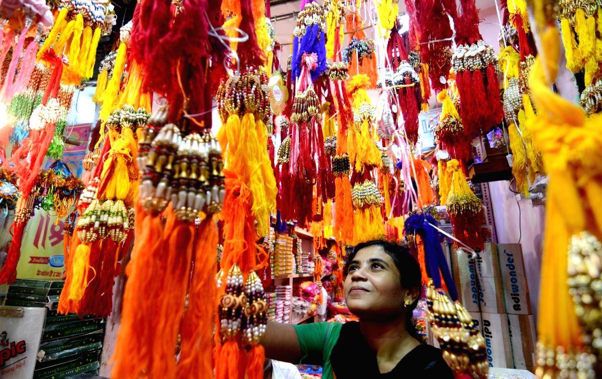 Kolkata: A woman busy buying rakhis ahead of Raksha Bandhan in Kolkata on Aug 4, 2019. (Photo: Kuntal Chakrabarty/IANS)