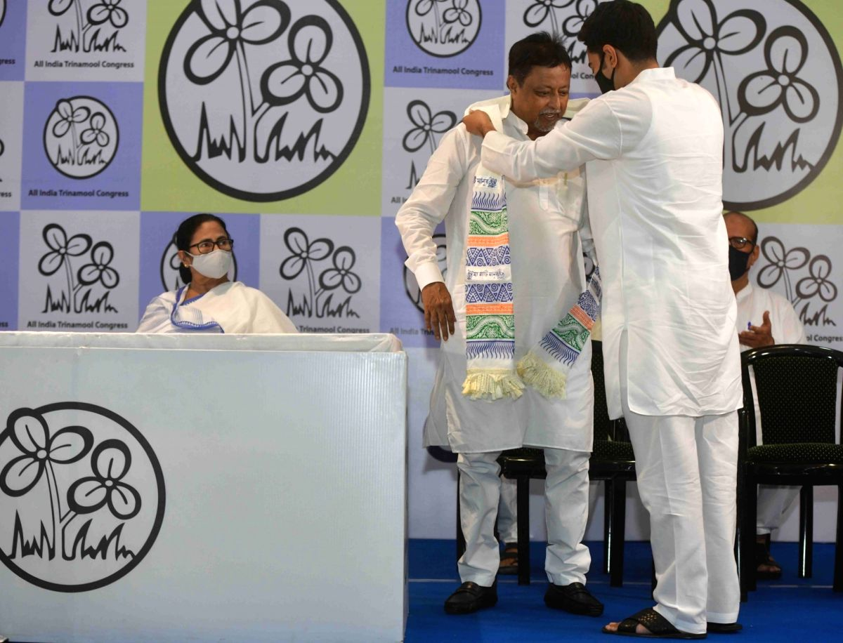 Kolkata:  BJP leader Mukul Roy with his son rejoined TMC in presence of TMC Supremo and West Bengal Chief Minister Mamata Banerjee, party's National General Secretary Abhishek Banerjee and others at TMC Bhawan in Kolkata on Friday 11 June 2021. (Phot