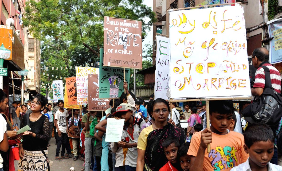 Kolkata: Children of sex workers participate in a rally against child marriage in Kolkata, on Sep 4, 2015. (Photo: Kuntal Chakrabarty/IANS)